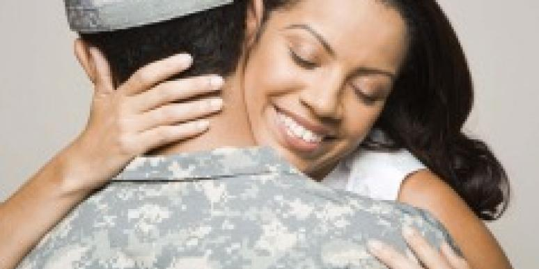 Woman embracing man in fatigues