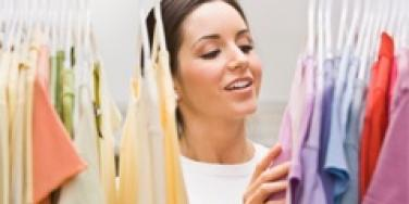 woman looking through her closet for clothing to wear