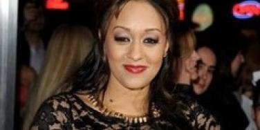 Tia Mowry arrives at the premiere of Battle: Los Angeles.