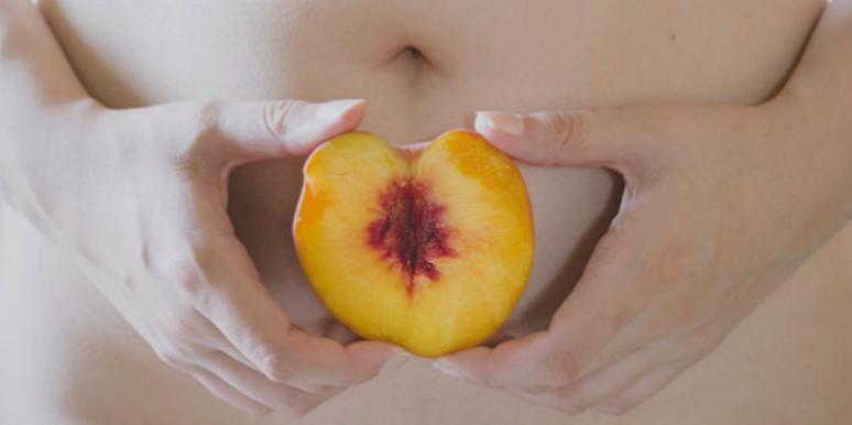 woman with peach that looks like vagina