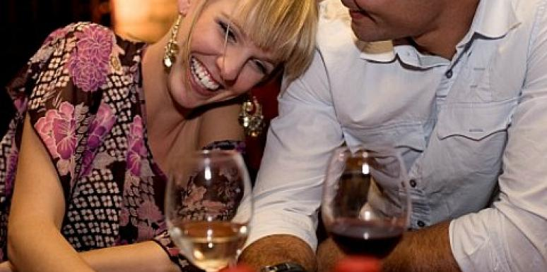 flirty couple at a bar with wine