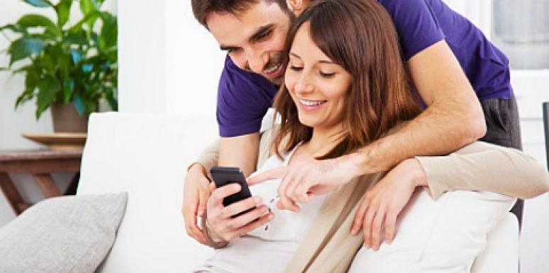couple looking at smartphone