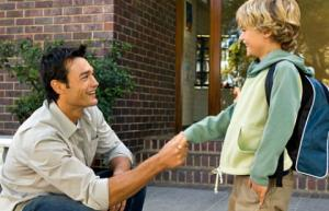 boy shaking hands with man