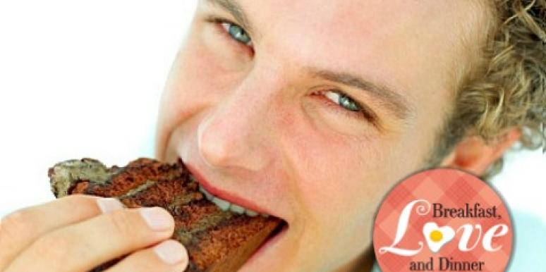 man eating brownie