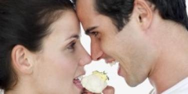 Couple sharing a piece of cauliflower