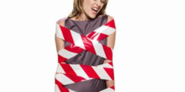 woman wrapped in red and white tape