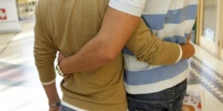 Men hugging in a shopping mall