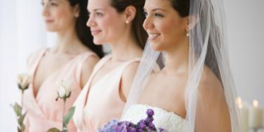 bride and bridesmaids waiting at the altar