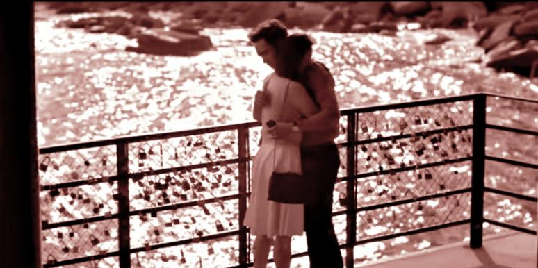 couple hugging on bridge