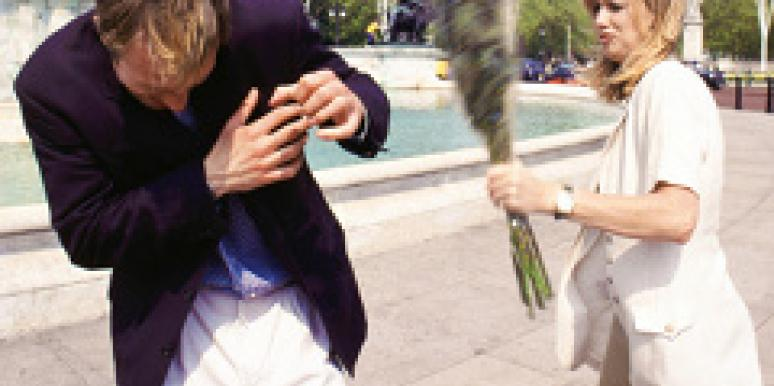 A woman confronts a man with flowers