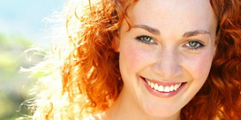 red hair curls smiling woman