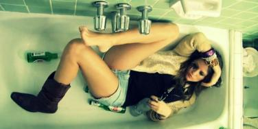 woman with a hangover in the bathtub