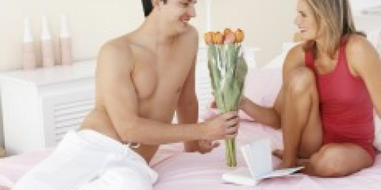 Man giving girlfriend flowers