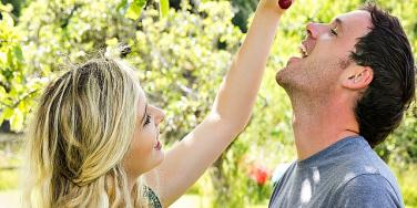 couple with grapes.