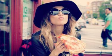 woman eating pizza