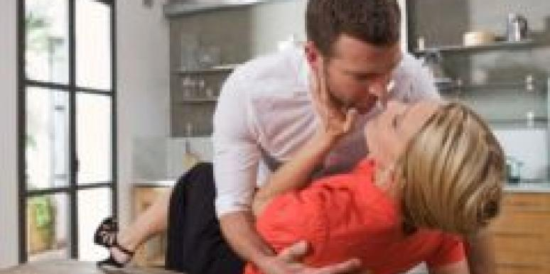 couple making out on kitchen counter