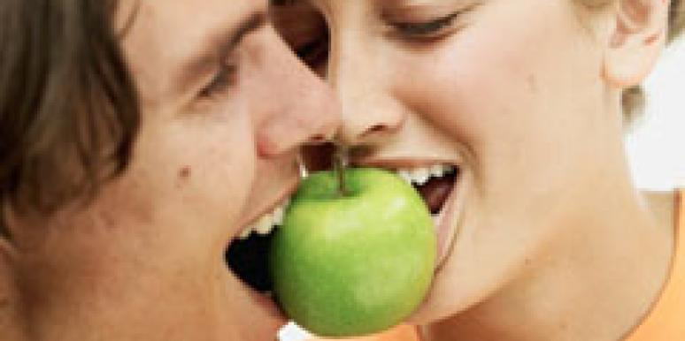 couple biting apple