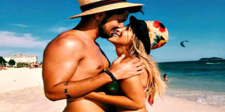 Couple in hats at the beach.