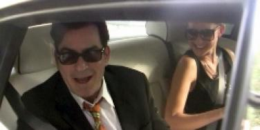 Charlie Sheen and goddess head to custody hearing in Rolls Royce.