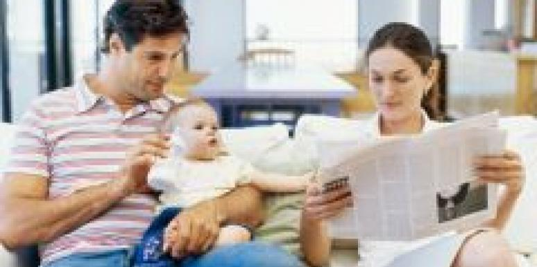 couple reading with baby