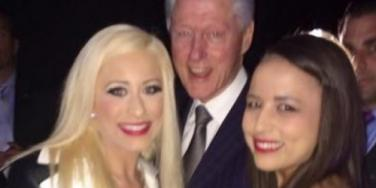 Former President Bill Clinton partying with Moonlite Bunny Ranch prostitutes Barbie Girl (left) and Ava Adora (right)
