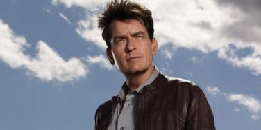 "Charlie Sheen in a promotional image for ""Anger Management,"" standing in front of a blue, partly cloudy sky"