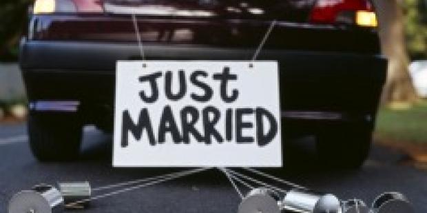 Back of car with just married sign on it