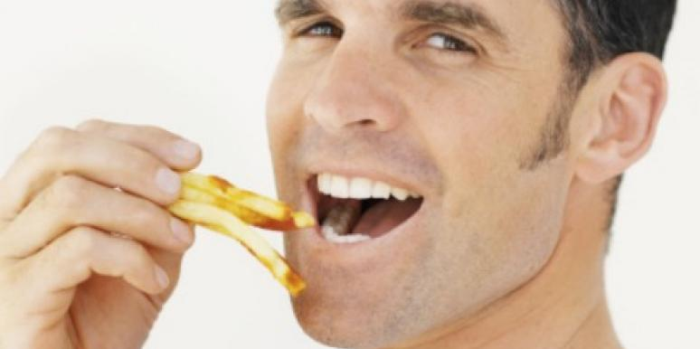 man eating fries
