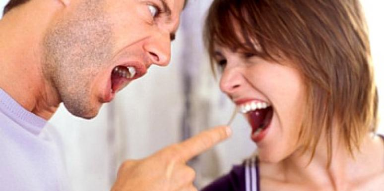 couple arguing pointing finger
