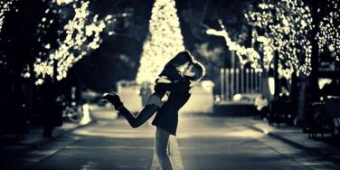 couple in front of christmas tree
