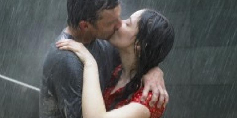 Couple kissing in the rain