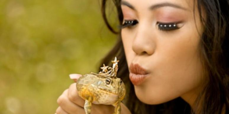 woman kissing frog