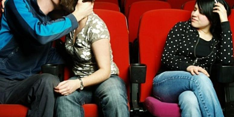 couple kissing at the movies
