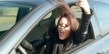 angry woman behind the wheel