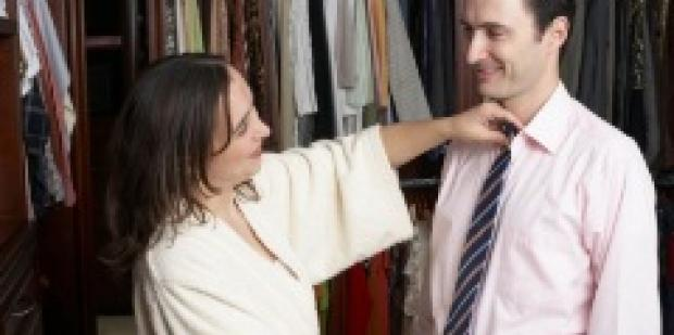 man helping husband pick out tie
