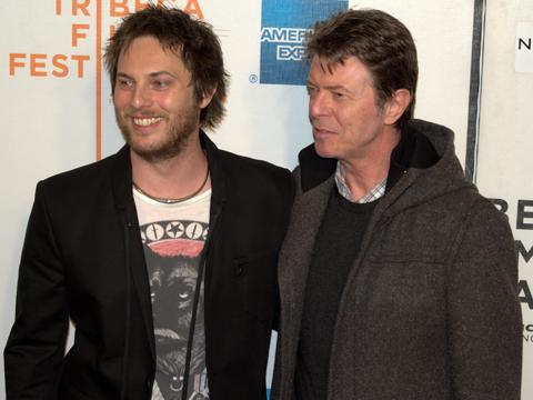 """<a href=""""http://upload.wikimedia.org/wikipedia/commons/a/af/Duncan_Jones_and_David_Bowie_at_the_premiere_of_Moon.jpg""""/>Zowie Bowie</a>"""