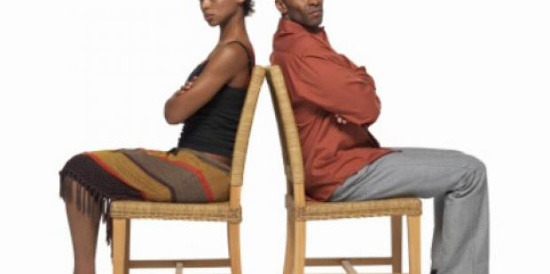 woman and man in back to back chairs