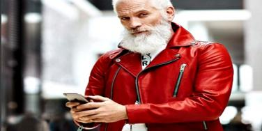 Fashion Santa in a red leather jacket.