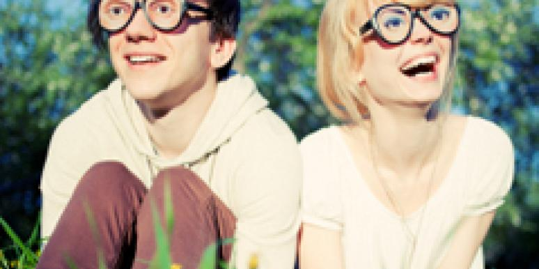 couple with glasses in grass