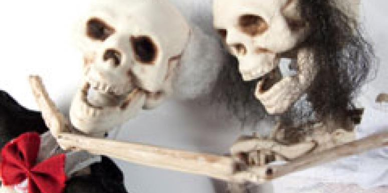 skeleton couple in tux and dress