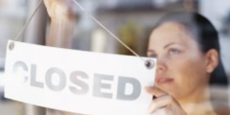 woman with closed for business sign