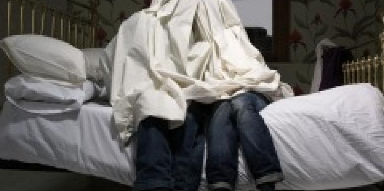 Couple hiding under sheets