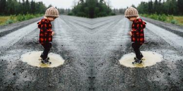 kid in puddle