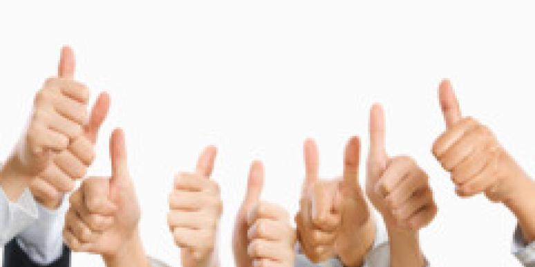 group of men giving thumbs up for approval