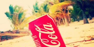 coke can in the sand